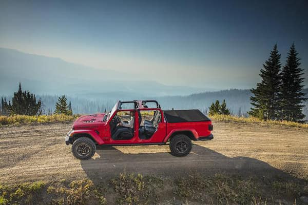 2020 Jeep Gladiator sideview driving on hill