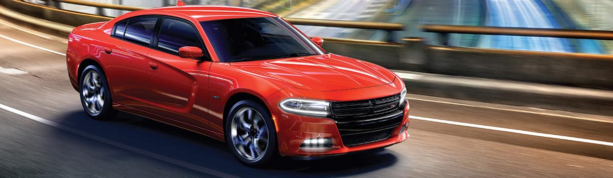 Dodge Charger red exterior driving