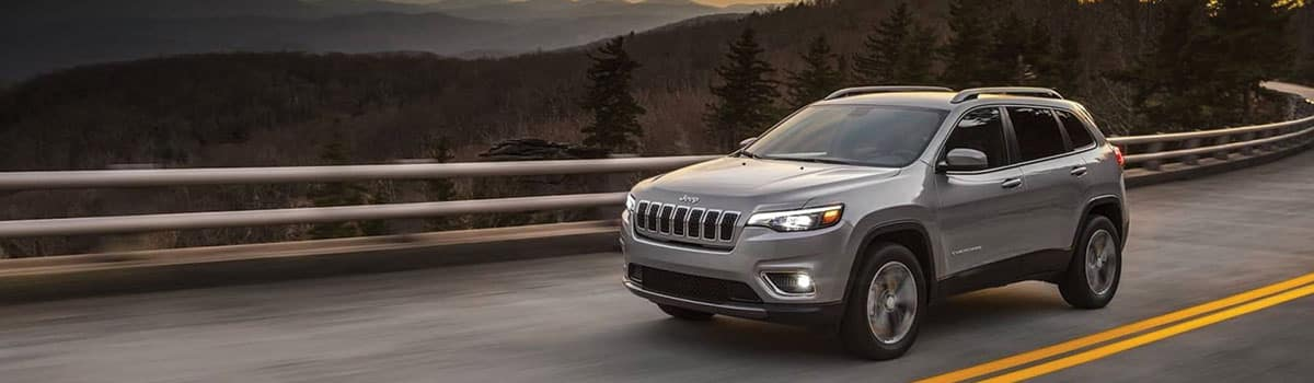 2019 Jeep Cherokee driving down hill