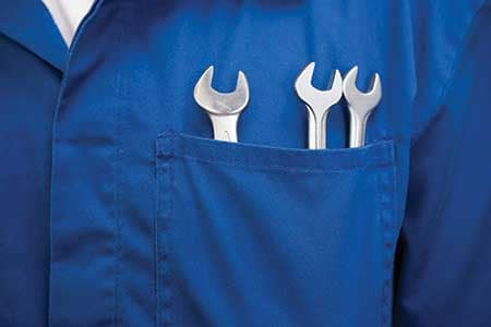 A service worker with tools in his pocket.