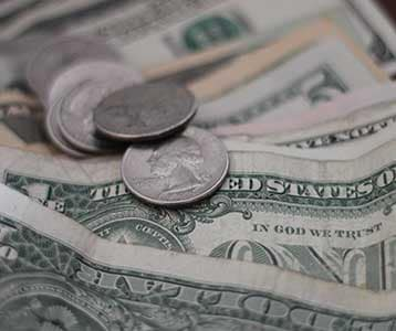Some dollar bills and change.