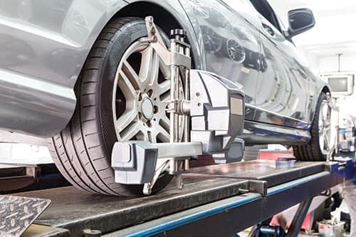 Wheels being aligned on a car