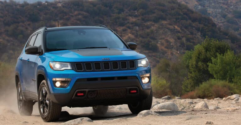 Blue 2019 Jeep Compass near mountains
