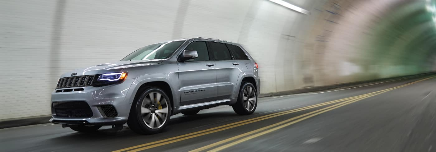 Silver Jeep Grand Cherokee in tunnel