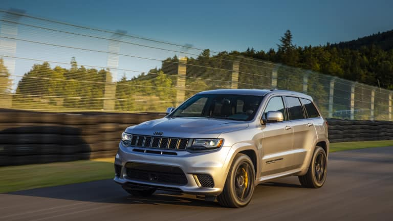 Silver Jeep Grand Cherokee on road