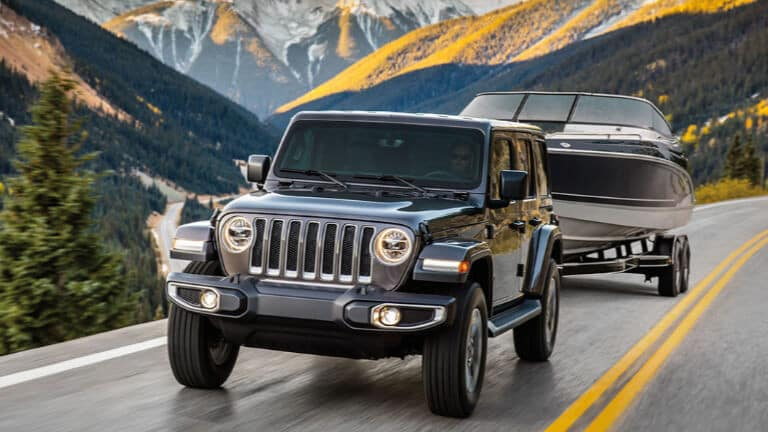 Grey 2019 Jeep Wrangler towing a boat