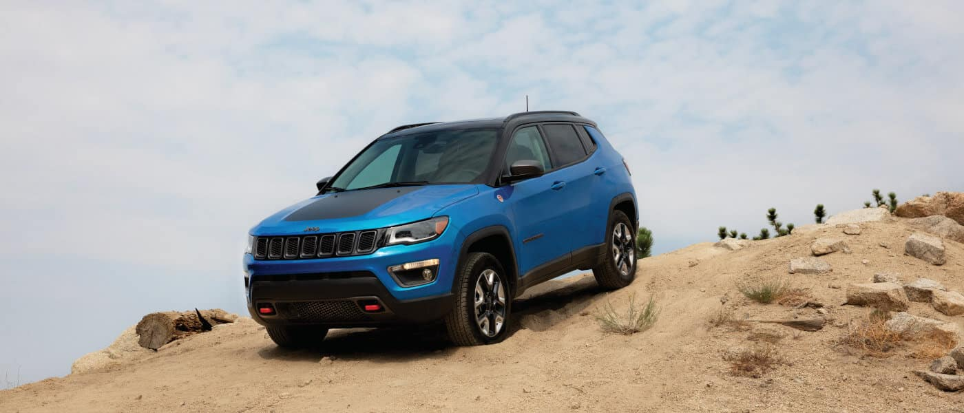 Blue 2018 Jeep Compass on hill