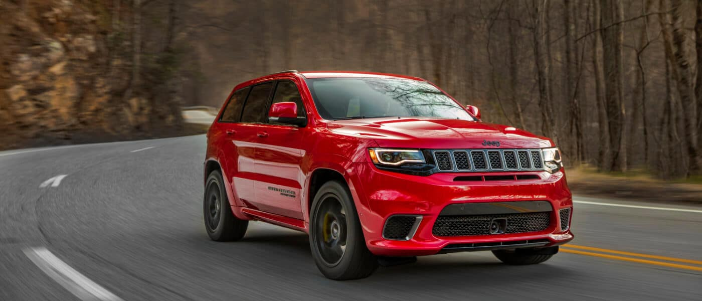 Red 2019 Jeep Grand Cherokee on road