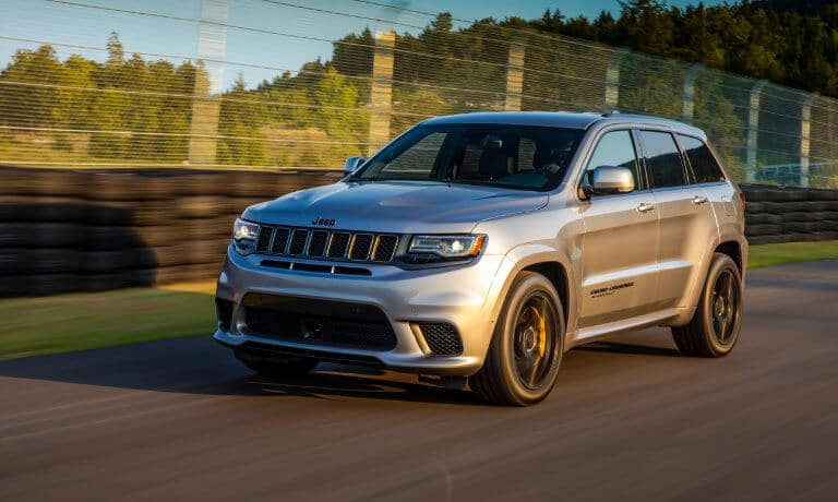 Silver 2019 Jeep Grand Cherokee on road