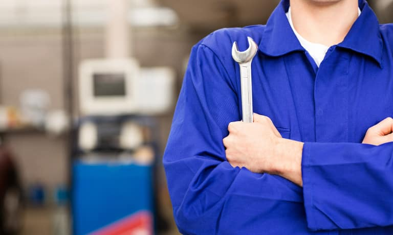 Car mechanic with tool