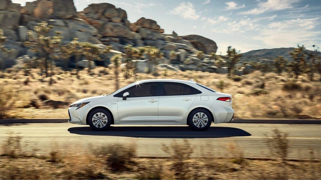 2021 Toyota Corolla speeding through a desert landscape