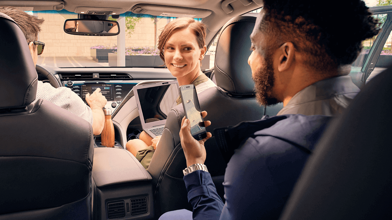 2018 Toyota Camry interior with passengers