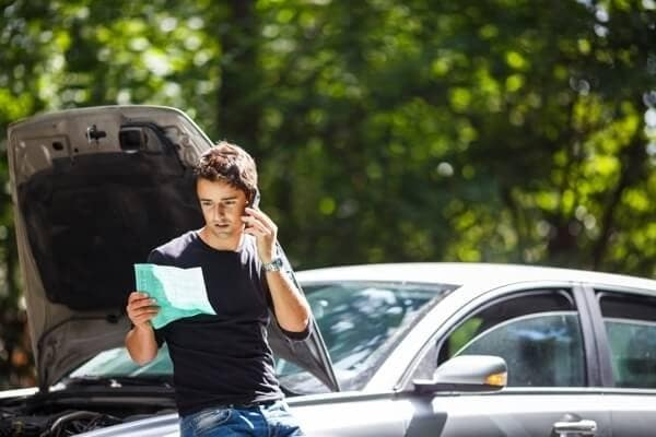 Man Calling help broke down on the side of the road