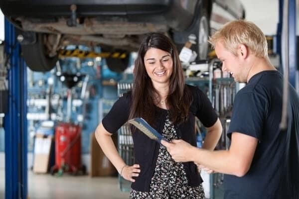 Mechanic Talking to Woman