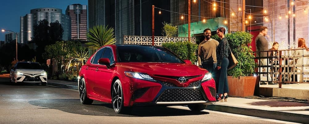 2019 Toyota Camry in red outside of restaurant