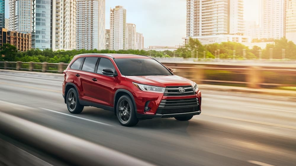2019 Toyota Highlander in red in the city