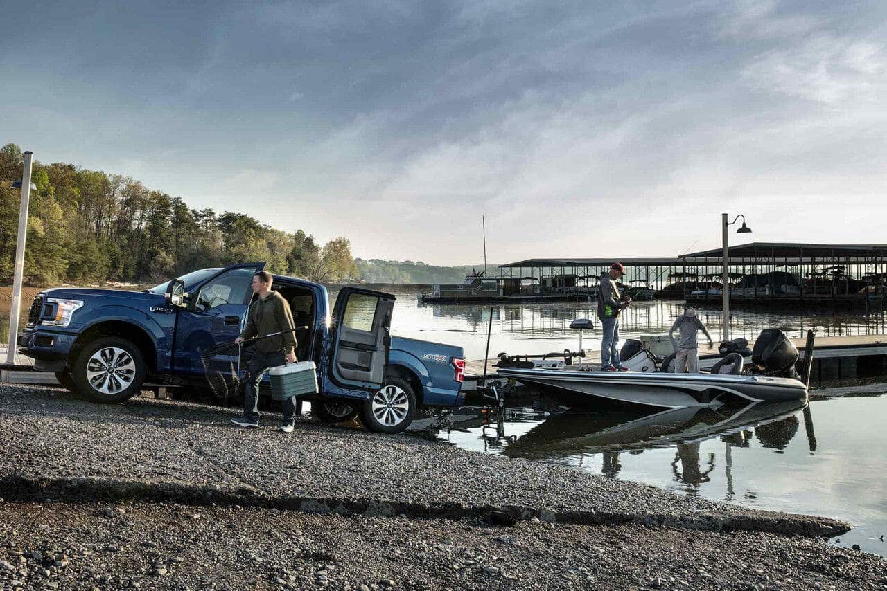 2018 Ford F-150 STX towing boat out of lake