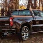 Back view of black 2019 Chevrolet Silverado 1500 in country woods