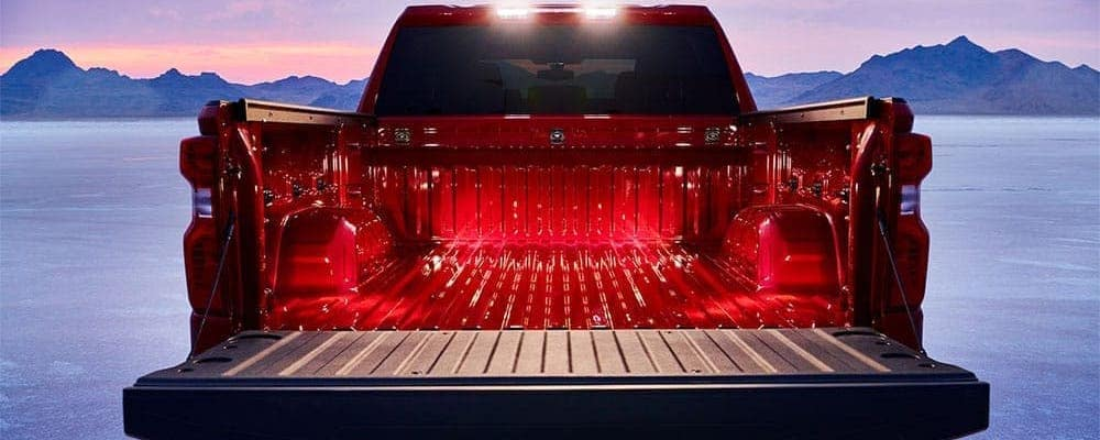Red 2019 Chevy Silverado trunk close-up with snowy mountain background