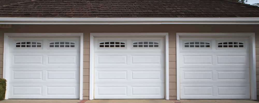 Three white garage doors