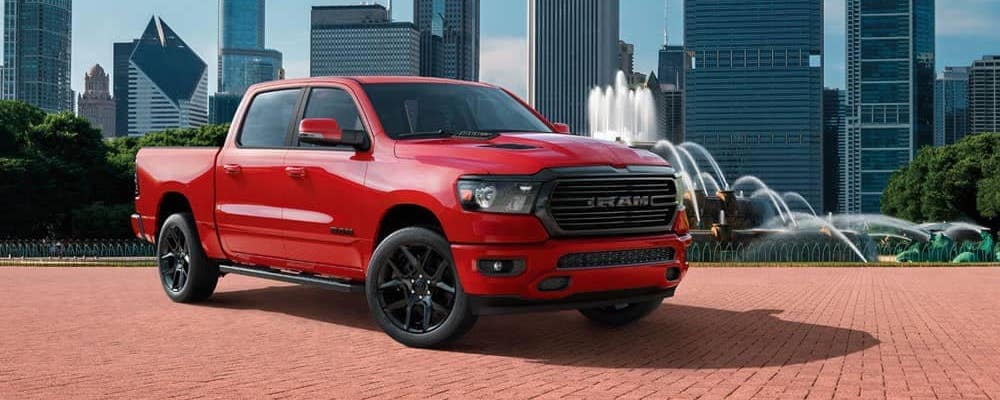 Red 2020 RAM 1500 Laramie parked in front of Chicago fountain and skyline